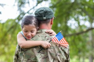 veteran dealing with PTSD carrying daughter